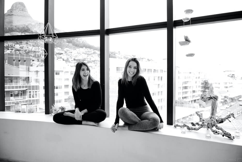Lexi and Dom on a window sill in the Wild Things yoga studio.