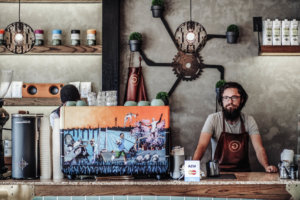 A barista in an article about increasing tips the Yoco way.