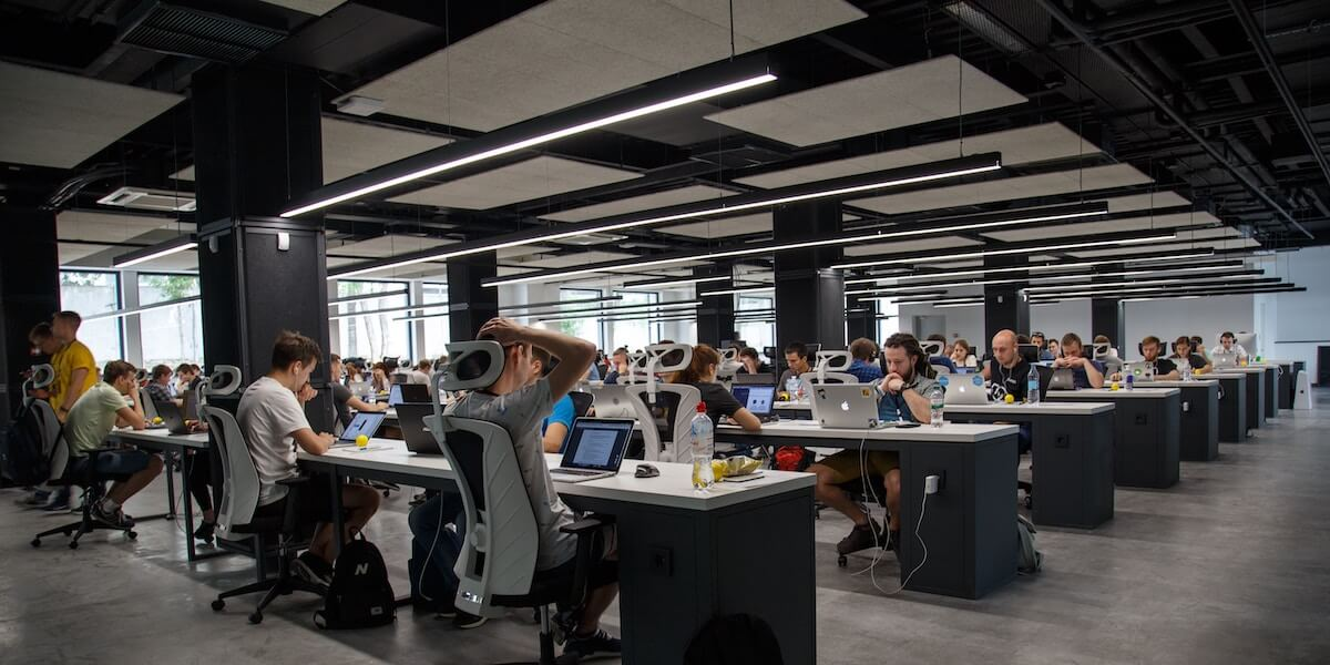 A room full of workers in article about employee rights.