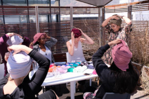 Rifqah of Riff-Wrapped teaches Yoco employees how to wrap a turban.