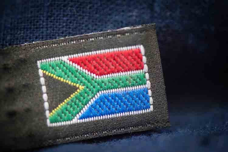 The South African flag stitched on a baby carrier from Ubuntu Baba.