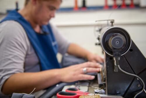 Nicolette working on her sewing machine at Ubuntu Baba.
