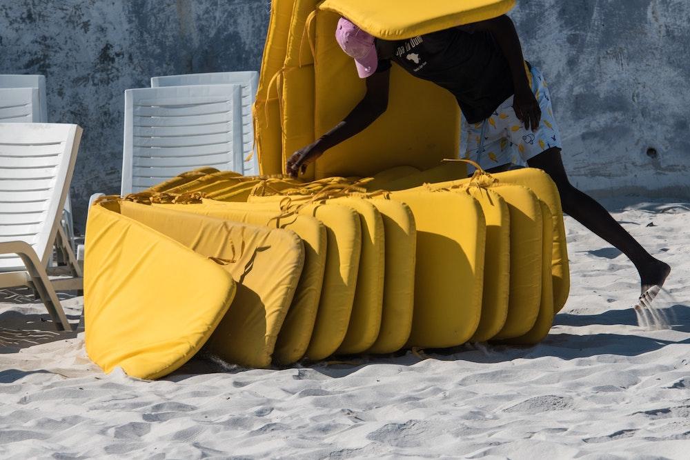 Cushions arranged on the beach.