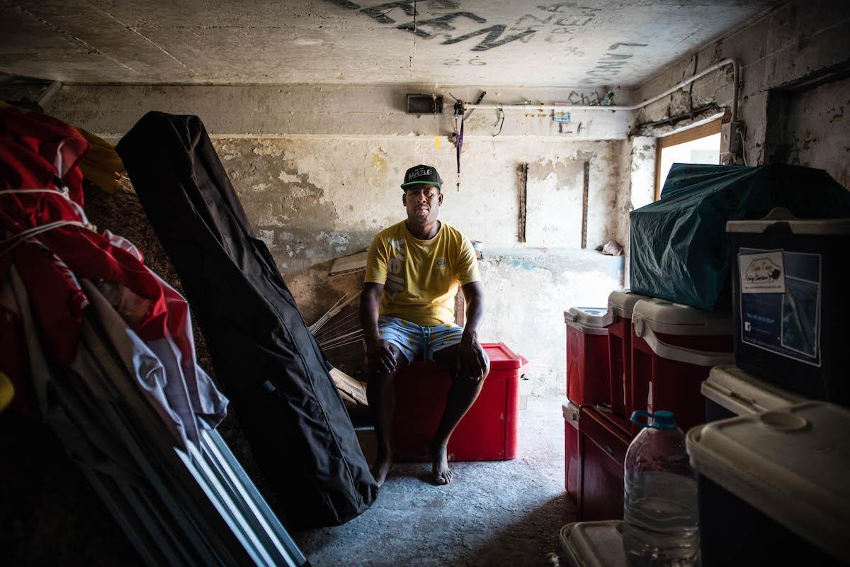 Gerald of JK Vending sitting in the storeroom.