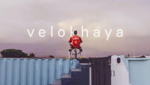A BMX rider on top of a container at Velokhaya Cycling Academy.