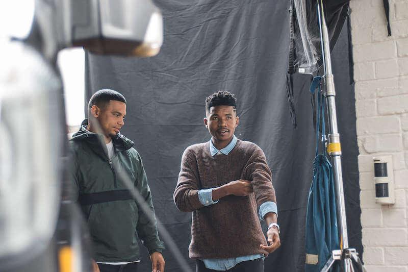 Between takes filming Sheldon Tatchell of Legend's Barbershop.