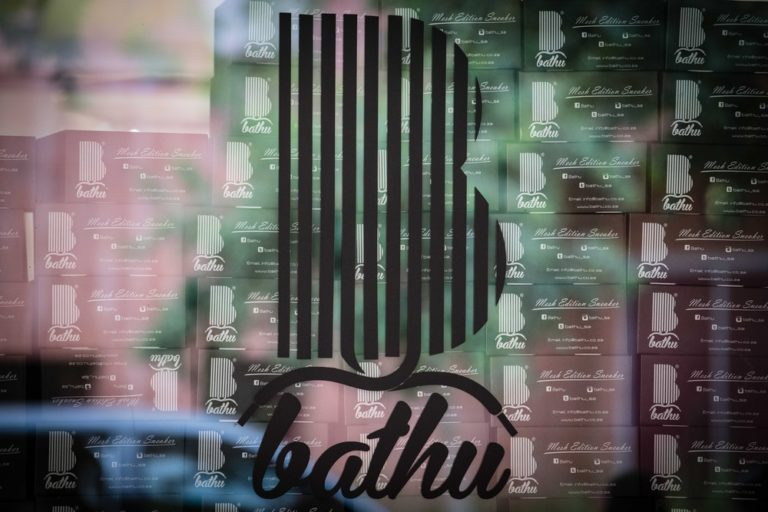 Bathu shoes logo on window.