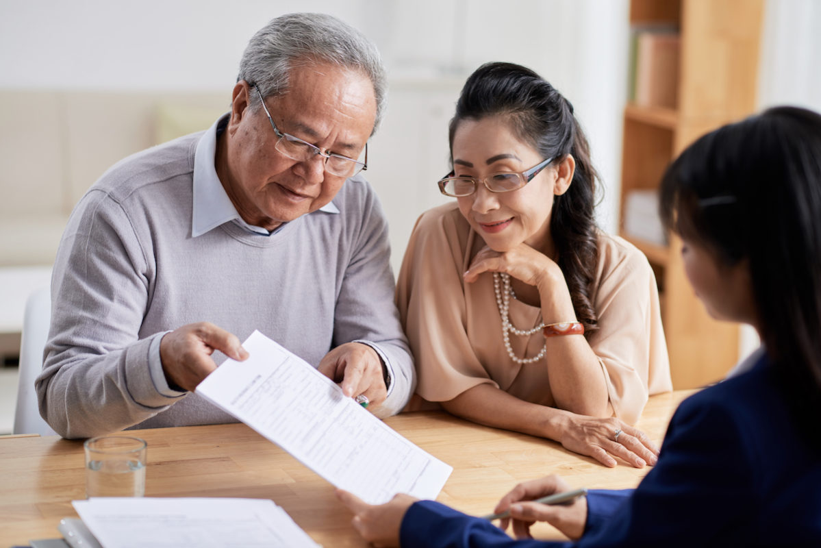 An image of two parents talking to their child in an article about getting funding from family and friends for your business.