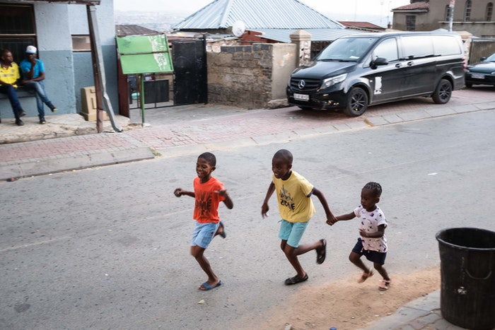 Kids playing the streets of Alex township.