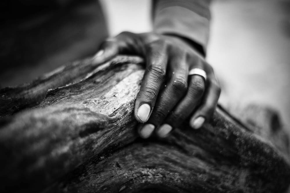 Touching and feeling the texture of the wood.
