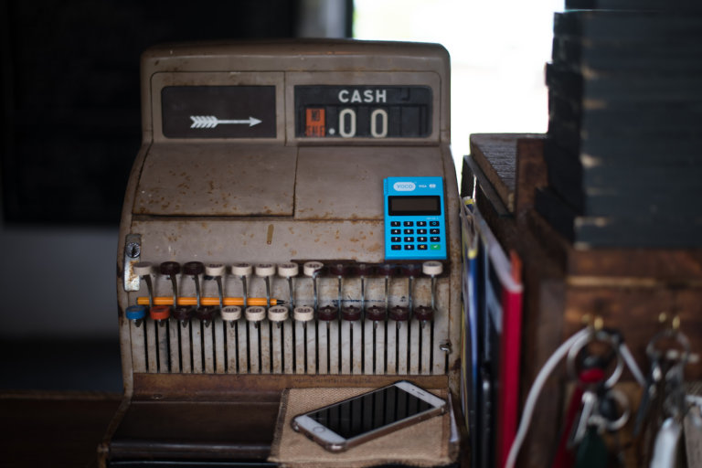 An image of an old typewriter in an article about financial inclusion.