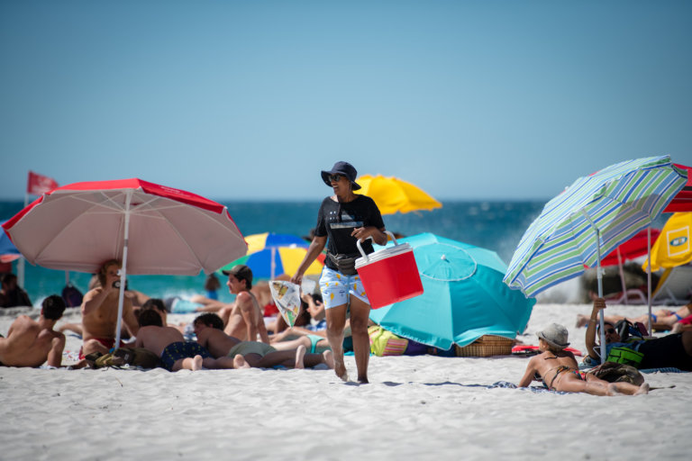 Selling lollies on the beach.