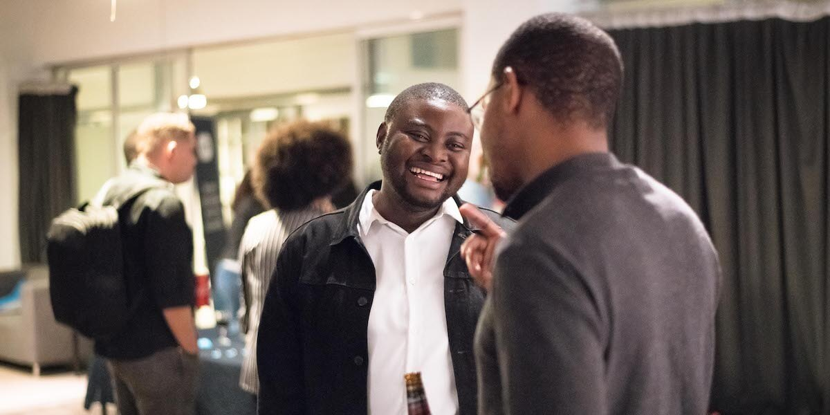 two men chatting at a business networking event