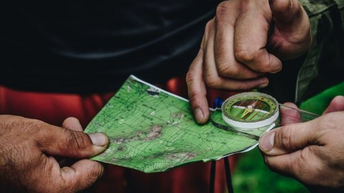 An image of a map and compass in an article about finding business advice and guidance.